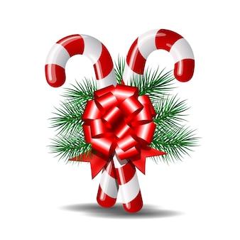 Bastoncini di zucchero di natale con fiocco rosso e ramo di albero di natale su bianco. illustrazione.