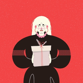Cartolina di natale con una ragazza alla moda in un vestito nero che tiene una confezione regalo