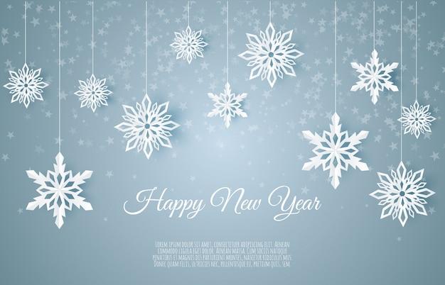 Cartolina di natale con fiocco di neve di carta, fiocchi di neve che cadono su uno sfondo invernale blu scuro,