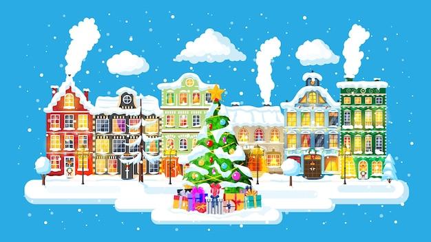 Cartolina di natale con paesaggio urbano e nevicate. paesaggio urbano con case colorate con neve nella notte. villaggio invernale, panorama accogliente della città della città. banner di natale di natale di capodanno. illustrazione vettoriale piatta