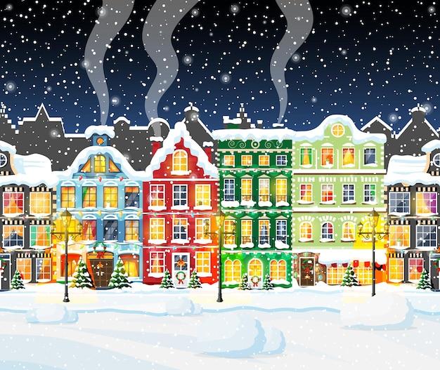 Cartolina di natale con paesaggio urbano e nevicate.