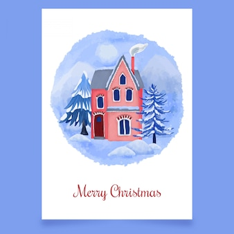 Cartolina di natale con casa d'inverno
