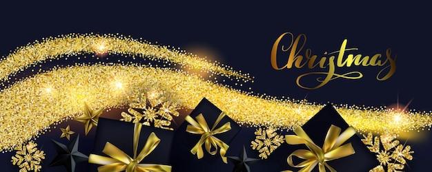 Composizione natalizia con fiocchi di neve dorati e scatole regalo su sfondo nero