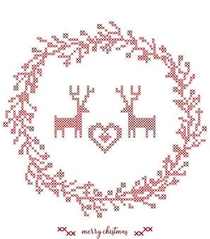 Ricamo a punto croce corona natalizia con renne natalizie.