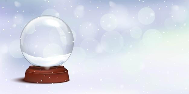 Globo di neve di cristallo di natale con luci bokeh