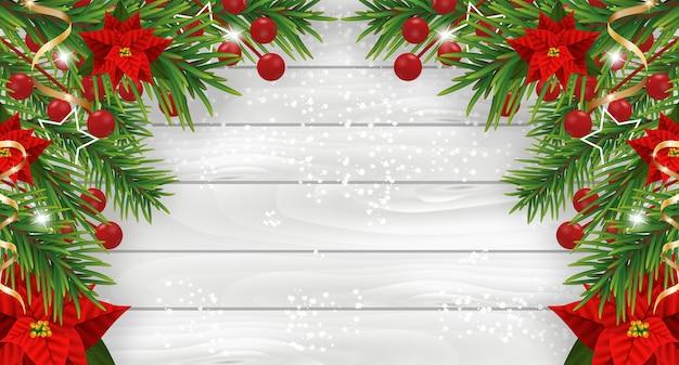 Addobbi natalizi con poinsettia e nastri dorati