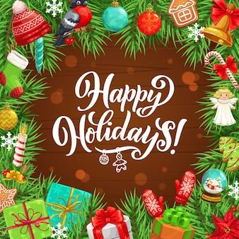 Cornice natalizia di albero di natale, regali, campane e fiocchi di nastro, fiocchi di neve, palline e calzino, bastoncino di zucchero, pan di zenzero e candela, cappello e guanto. ghirlanda di vacanze invernali su fondo in legno