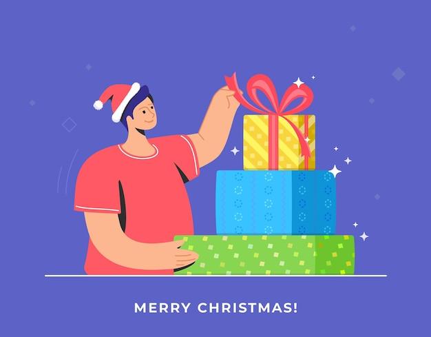 Disimballaggio dei regali di natale e regalo decorato con nastro rosso per celebrare il buon natale
