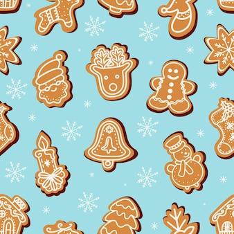 Biscotti di panpepato di natale in mezzo all'illustrazione dei fiocchi di neve
