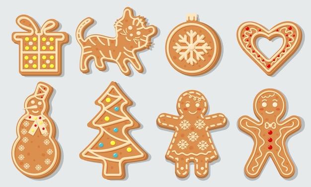 Biscotti di panpepato di natale a forma di palla di natale, albero di natale, tigre, cuore, pupazzo di neve, regalo e uomini di pan di zenzero. dolci biscotti glassati fatti in casa.