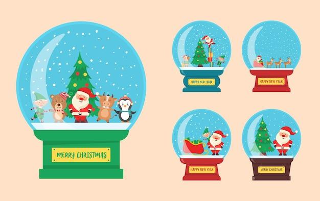Globo di souvenir con palla di vetro di natale con personaggi di una piccola città in inverno all'interno di un globo di neve
