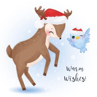 Biglietto di auguri di natale con adorabili renne e uccelli