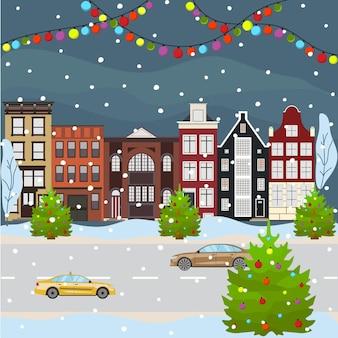 Paesaggio urbano di natale e felice anno nuovo che celebra le vacanze invernali costruzione di cartoni animati in stile piatto