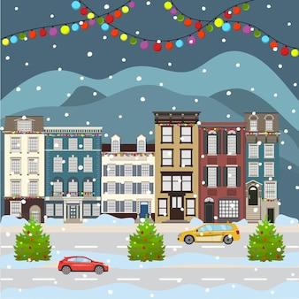 Paesaggio urbano di natale e felice anno nuovo che celebra le vacanze invernali città di un vecchio edificio dei cartoni animati