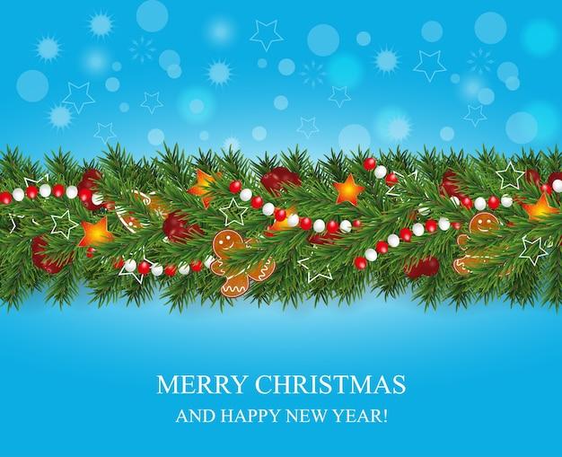 Ghirlanda di natale e felice anno nuovo e bordo di rami di albero di natale dall'aspetto realistico decorato con bacche, stelle e biscotti di panpepato, perline. decorazione di festa su sfondo blu.