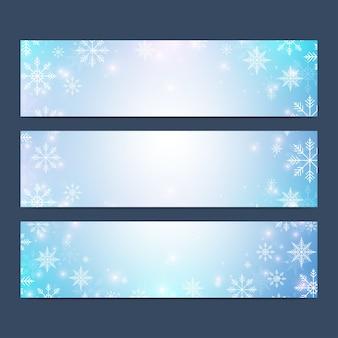 Natale e felice anno nuovo set di banner con fiocchi di neve.