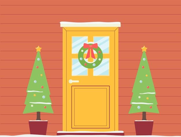 Vacanze di natale decorato sfondo porta con ghirlande e ghirlande sfondo o modello di layout per biglietti di auguri invernali.