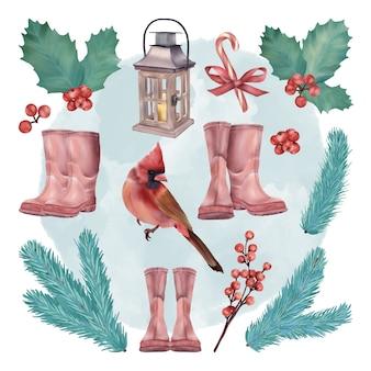 Set di decorazioni natalizie con stivali di babbo natale e uccello rosso