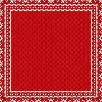 Priorità bassa lavorata a maglia di disegno di festa di natale con un posto per testo. imitazione di texture maglione lavorato a maglia di lana.