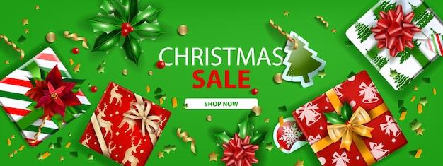 Banner di vendita vacanze natalizie vettore inverno verde sconto pagina di destinazione web vista dall'alto confezione regalo fiocco
