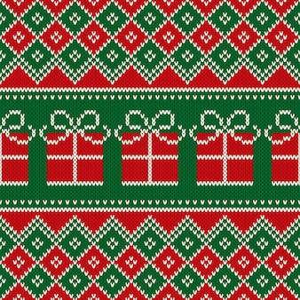 Reticolo lavorato a maglia senza giunte di festa di natale con scatola presente. schema per disegno modello maglione di lana lavorata a maglia o ricamo a punto croce.