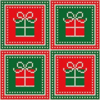 Fondo di struttura della maglia di lana senza cuciture di festa di natale con l'ornamento della scatola regalo