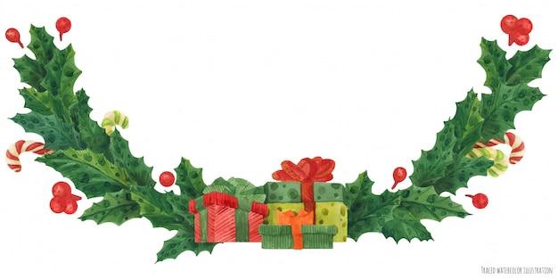 Ghirlanda di agrifoglio di natale con scatole regalo e bastoncini di zucchero