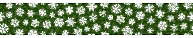 Insegna orizzontale senza cuciture di natale dei fiocchi di neve bianchi su fondo verde
