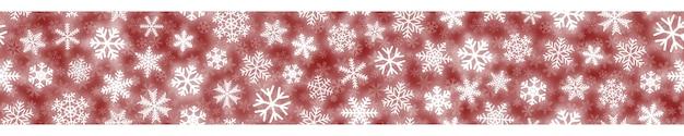 Insegna orizzontale senza cuciture di natale dei fiocchi di neve bianchi su fondo rosso
