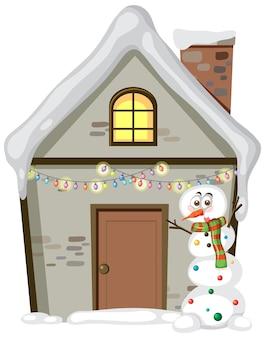Casa di natale con pupazzo di neve su sfondo bianco