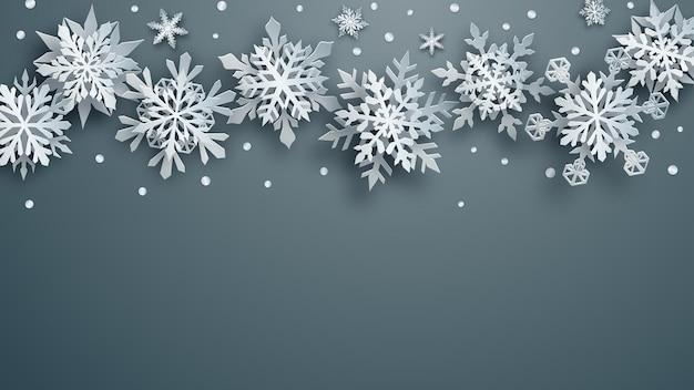 Illustrazione natalizia di fiocchi di neve di carta bianchi complessi con ombre morbide su sfondo grigio