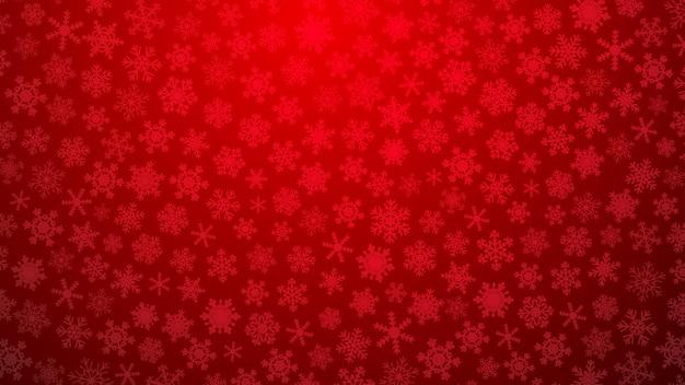 Illustrazione di natale con vari piccoli fiocchi di neve su sfondo sfumato in colori rossi