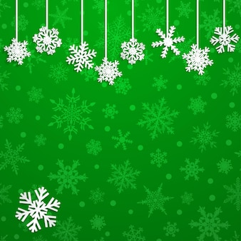 Illustrazione di natale con fiocchi di neve appesi bianchi su sfondo verde