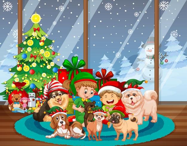 Scena di natale al coperto con molti bambini e simpatici cani