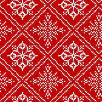 Ornamento geometrico lavorato a maglia di natale. modello senza cuciture strutturato lavorato a maglia