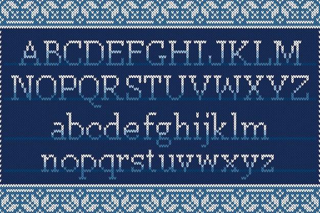 Alfabeto latino a maglia di natale su sfondo senza soluzione di continuità