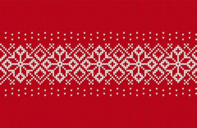 Modello natalizio a maglia. bordo rosso senza soluzione di continuità. trama a maglia. sfondo di natale. stampa dell'isola della fiera delle vacanze
