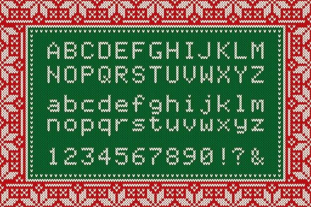Lettere e numeri di alfabeto latino di carattere lavorato a maglia di natale su sfondo senza giunte di maglia di lana