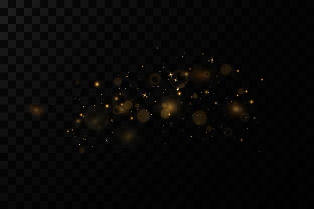 Effetto luce natalizia particelle di polvere magiche scintillantile scintille di polvere e le stelle dorate brillano