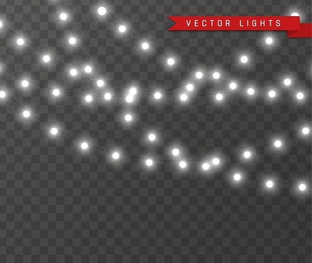 Luci di natale isolate su sfondo trasparente. set di lampada ghirlanda incandescente di natale.