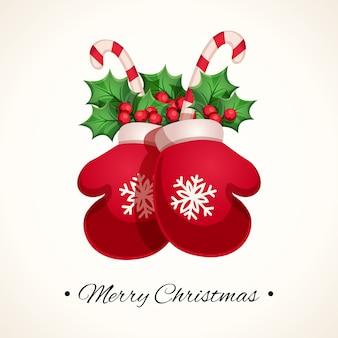 Guanti di natale con altri elementi decorativi un biglietto di auguri di felice anno nuovo e buon natale.