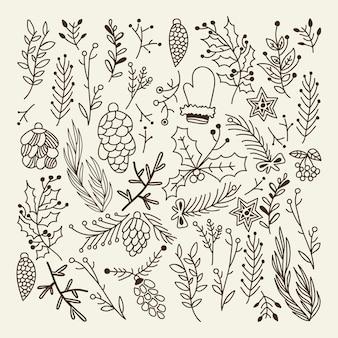 Composizione naturale di natale impostata con rami di albero, coni ed elementi tradizionali invernali su grigio