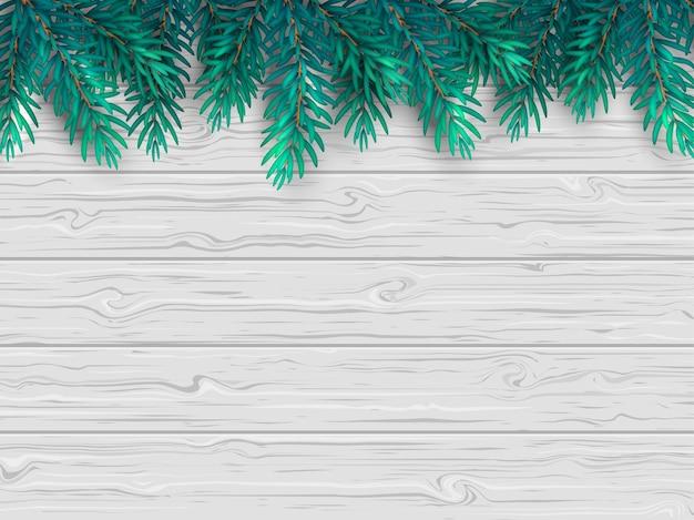 Sfondo di natale o capodanno con rami di abete realistico su un tavolo in legno bianco.