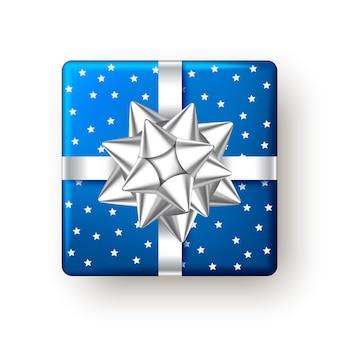 Scatola regalo di natale capodanno blu con nastro d'argento e fiocco