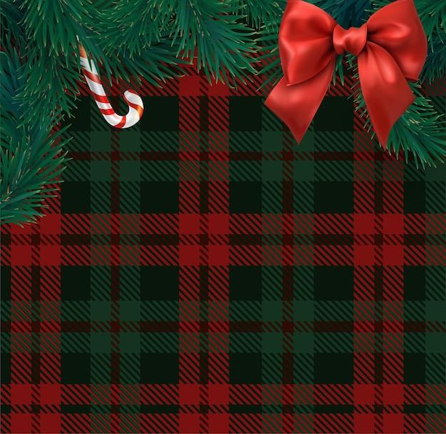 Modello di biglietto di natale e capodanno con rami di abete a scacchi rossi e verdi scozzesi e fiocco di raso
