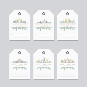 Set di modelli di etichette o badge regalo pronti per l'uso di natale e capodanno. pino aghi di abete disegnato a mano con etichette per cornici di strobili e foglie di agrifoglio schizzi saluti. isolato.