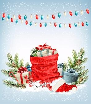 Regali di natale con una ghirlanda e un sacco pieno di scatole regalo