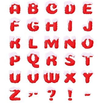 Lettere rosse di natale con cuciture in stile cartone animato, cosparse di neve.