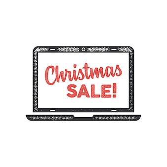 Iscrizione di vendita di natale ed elementi di tipografia sullo schermo del laptop