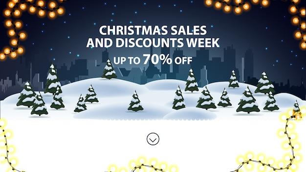 Settimana di saldi e sconti natalizi, fino a 70 di sconto, banner di sconto per sito web con paesaggio invernale notturno